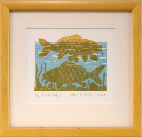 Framed artwork by Anne Miles of 2 yellow Carp with rocks and weeds in a blue water background