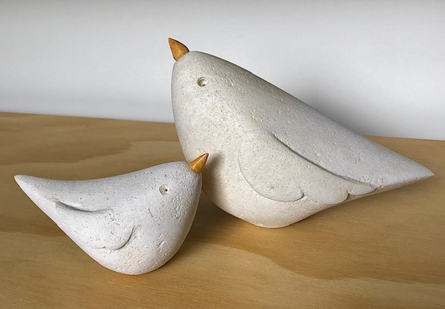 Limestone mother and baby bird sculpture with applewood beaks.
