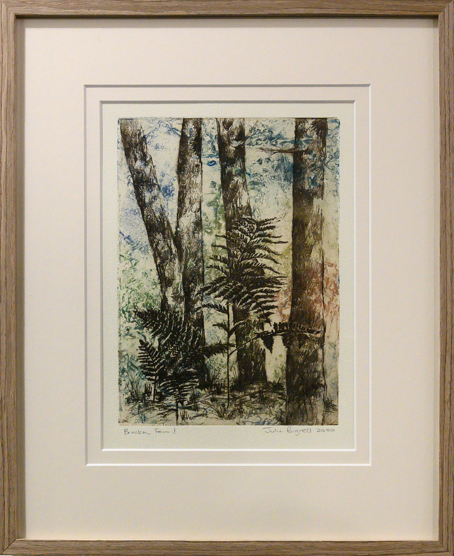 Framed artwork by Julie Bignell of bracken fern amongst tall tree trunks