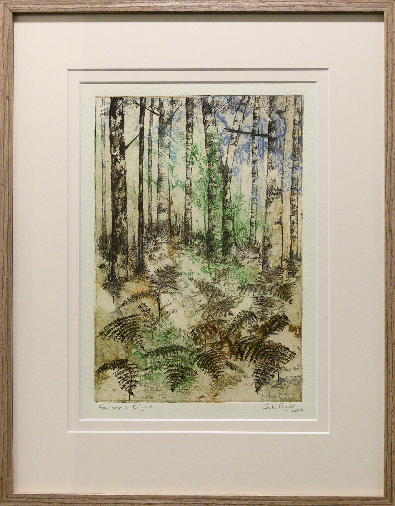 Framed artwork by Julie Bignell of bracken fern in the foreground with tall skinny tree trunks in the background