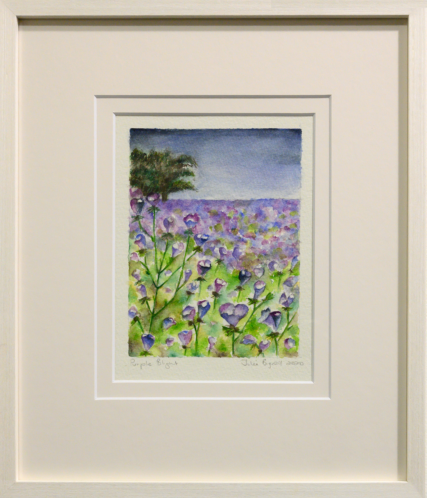Framed artwork by Julie Bignell of purple flowers in the foreground with a field of green and purple in the background and a tree