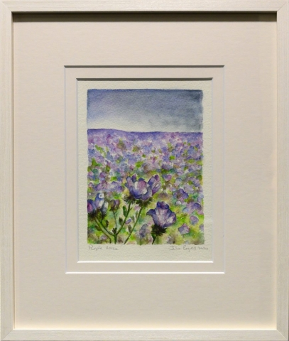 Framed artwork by Julie Bignell of purple flowers in the foreground with a field of purple flowers in the background and blue sky