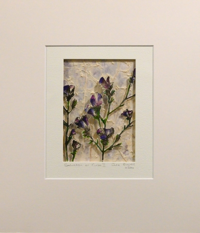 Unframed artwork by Julie Bignell of purple flowers cut out in the foreground with textured cream coloured paper in the background