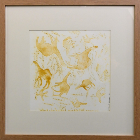 Framed artwork by Sally OConnor of simplistic yellow camels