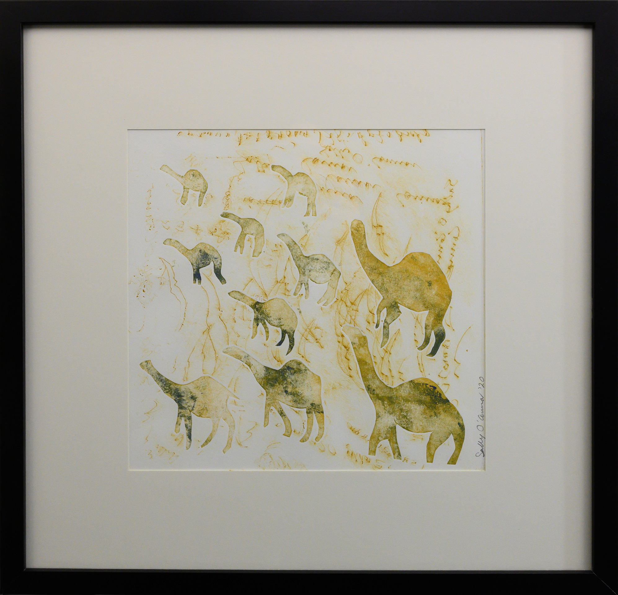 Framed artwork by Sally OConnor of simplistic yellow/green camels