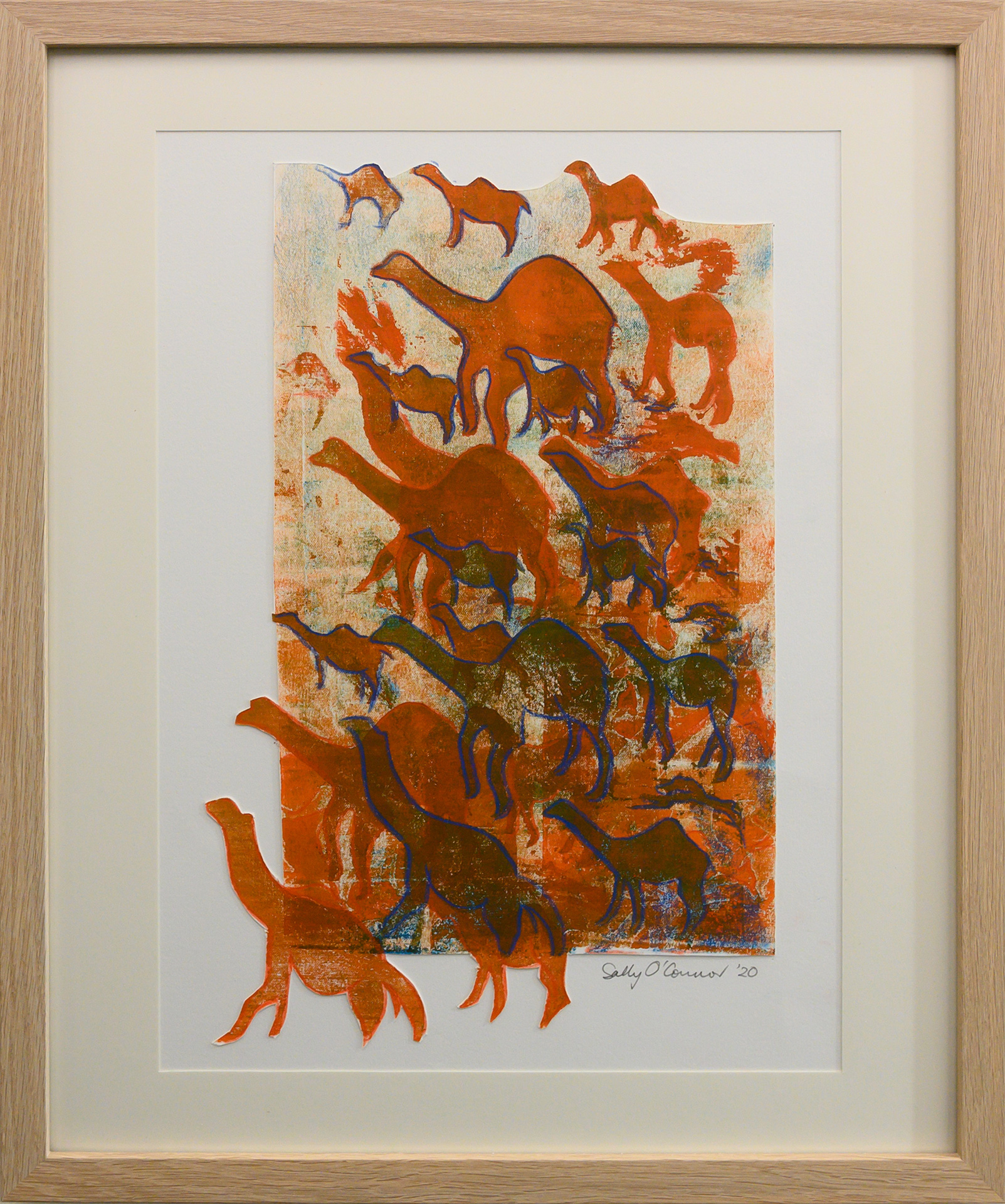 Framed artwork by Sally OConnor of layers of simplistic camels in ochre colours