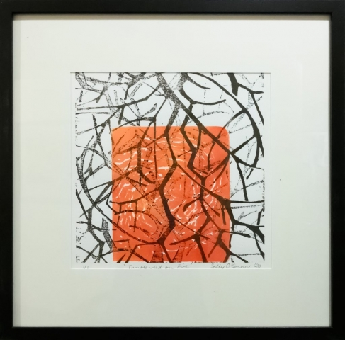 Framed artwork by Sally OConnor of layers of closeup black tumbleweed branches on a orange/red background