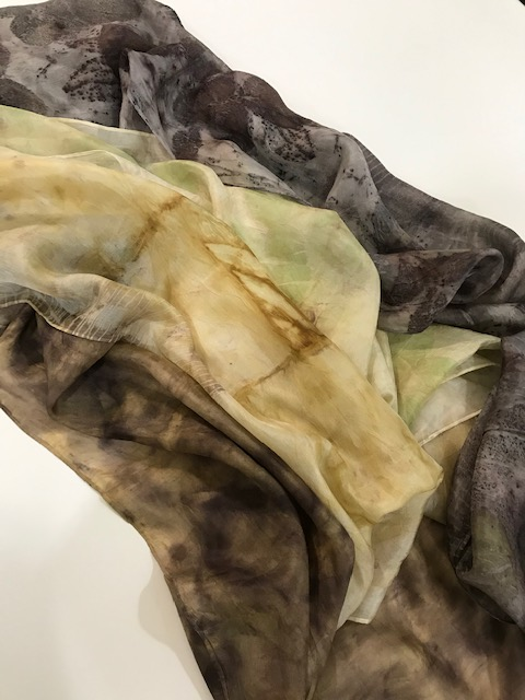 Silk scarves in varying brown shades using natural dyes.