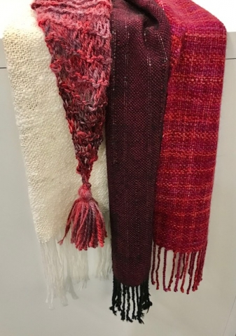 Merino Wool Scarves in varying red and white shades using natural dyes.