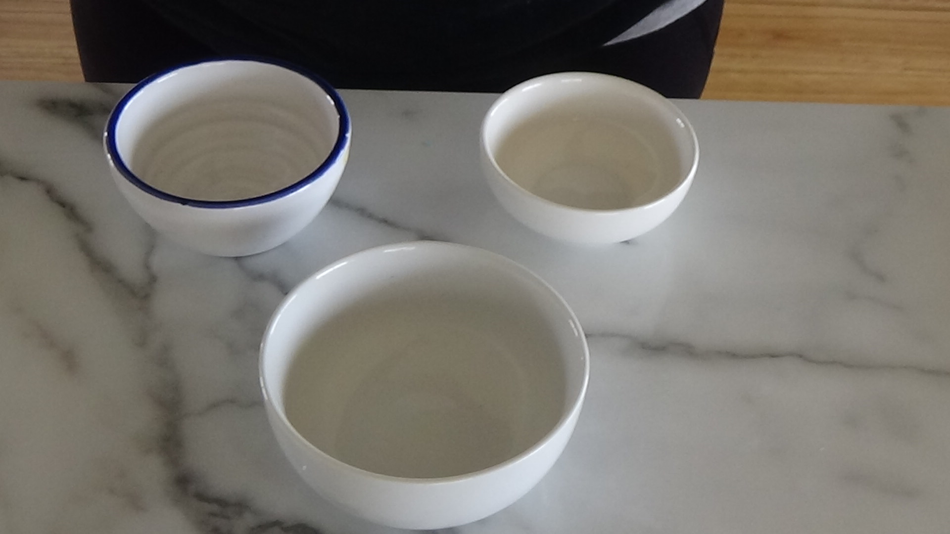 Ceramic bowls on countertop.