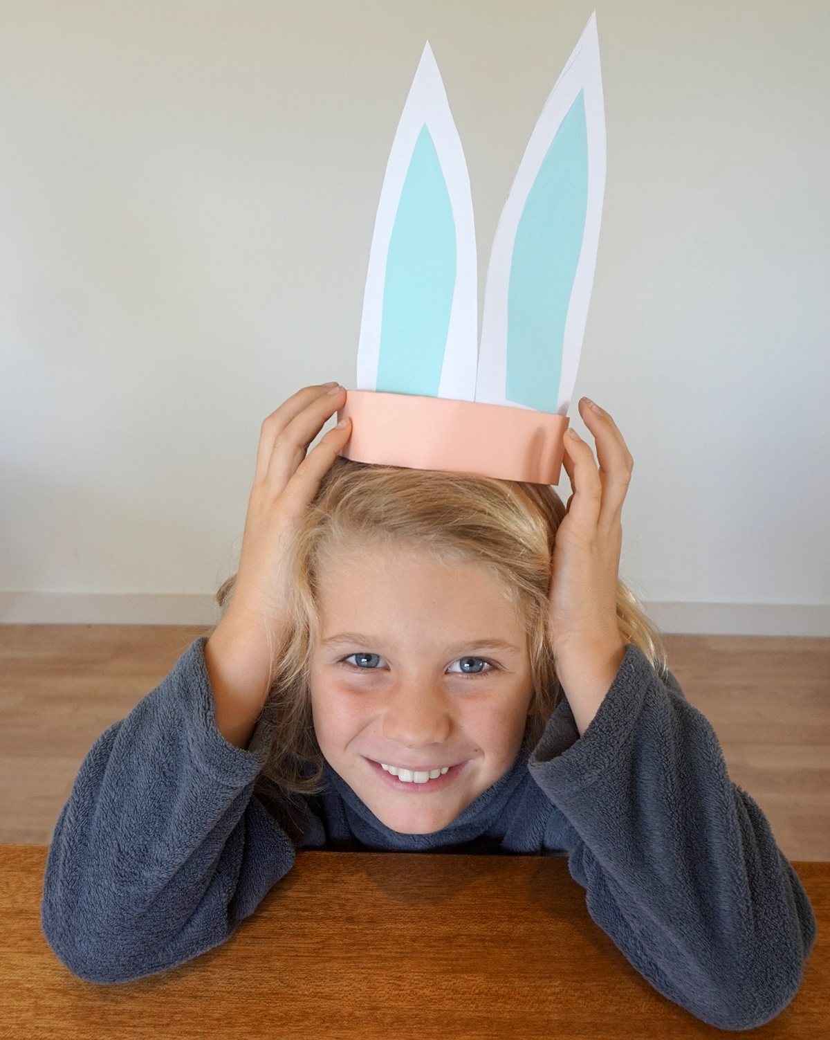 Boy wearing finished set of bunny ears showing alternate decorations.